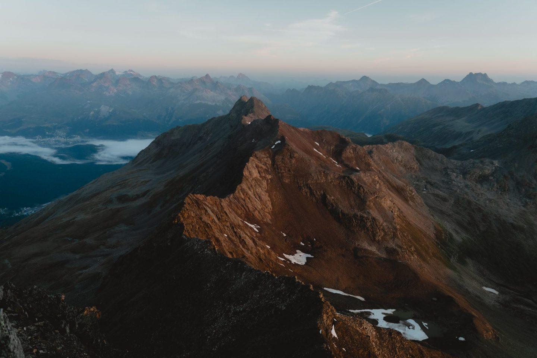 Mountain ridgeline illuminated by the sunrise