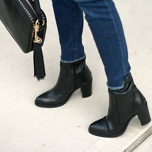 Loving these Brusque boots Gap frayed jeans and MichaelKors crossbodyhellip