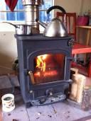 Eggs and kettle on burner