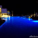 Dreams Playa Mujeres night view of the beachfront pool