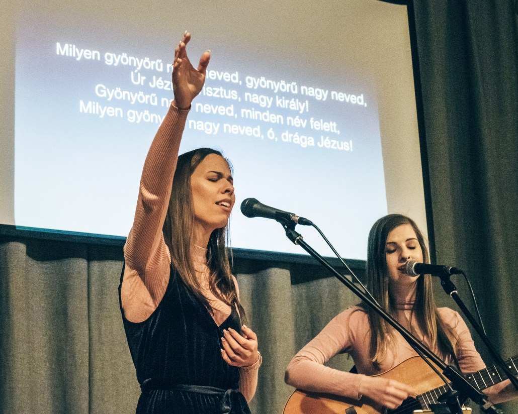 Women worship in at the All In Conference in Hungary