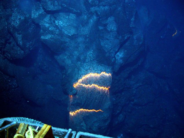 Glowing bands of magma around a rock