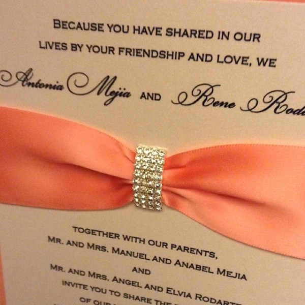 Loving these Crescent Crystal Buckle wedding invitations!! #allintheinvite #invitation #bling #coral #weddinginvitation #wedding #mexicanwedding #rhinestone #satin #ribbon #coralribbon #lovethem #elegant #luxury