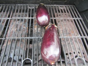 Eggplants, roasting on the grill for about 30 minutes.