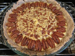 Pie, adorned with spiced pecans, and placed back into the oven.
