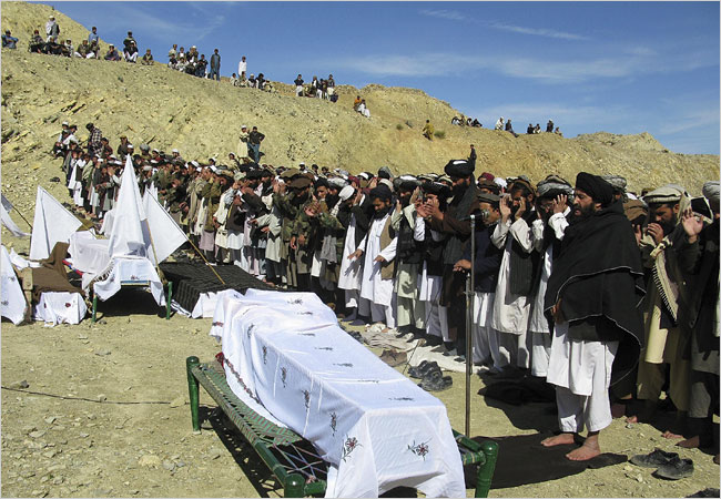 Members of Pakistani tribes offered funeral prayers on Feb. 15 for victims of an American missile attack in the North Waziristan region, near the Afghan border. (Reuters)