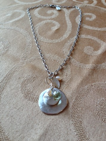 Happiness with pearl, faceted glass, and stainless steel chain.