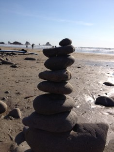 Tribute rocks are scattered throughout the beach.