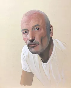 bald man on wearing white teeshirt on beige background