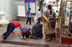 DEVOTION. Before entering the temple men and women prostrate themselves. Chennai, India.