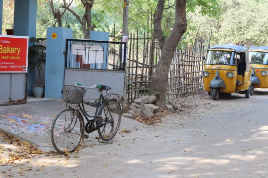 BICYCLE in front of a house-turned-computer store in Tiruvannamalai, India.