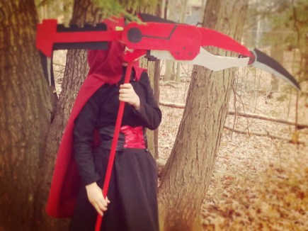 Ruby Rose (RWBY) Cosplay: Costume assembled by B.; prop scythe blade is made from boamboard and mounted on a removable broomstick.