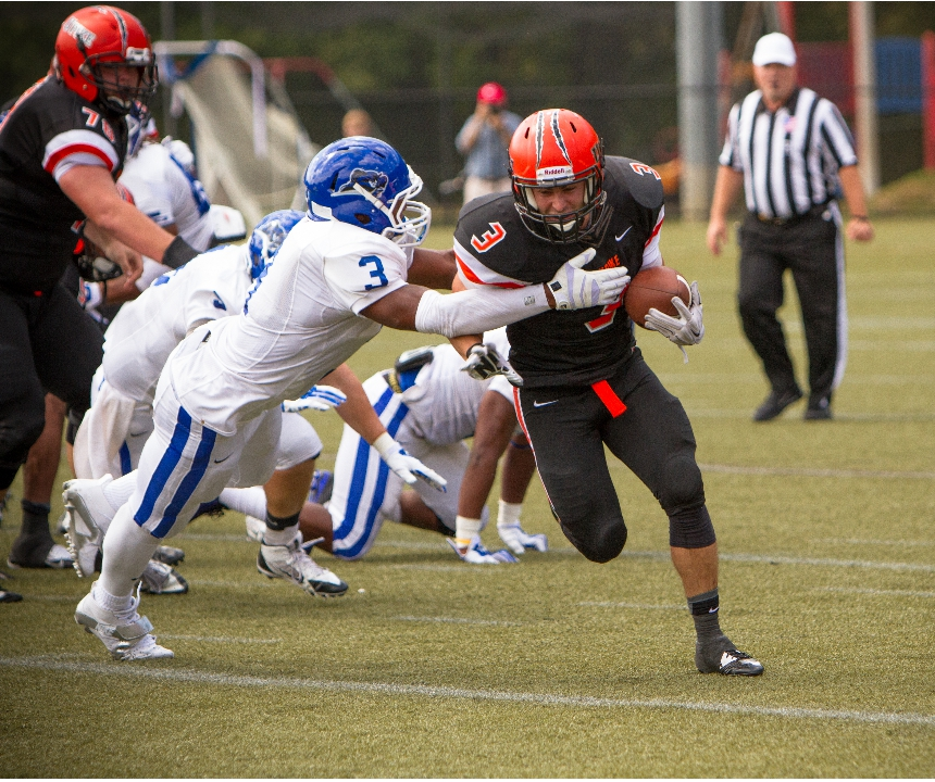Photo: Seth Millar carries the ball on Saturday on his way to a team-best 96 yards on the ground.
