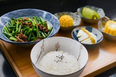 rice on bowl sliced egg corn and vegetable on table