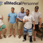 Team members rocking out their summer wear in the lobby of All Medical Personnel's Irving office