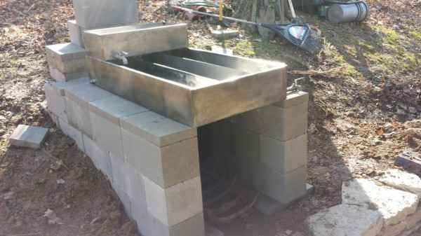Maple syrup arch v1, cinder block and evaporator pan.