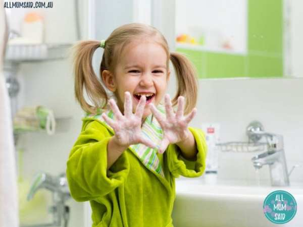 toddler washing her hands