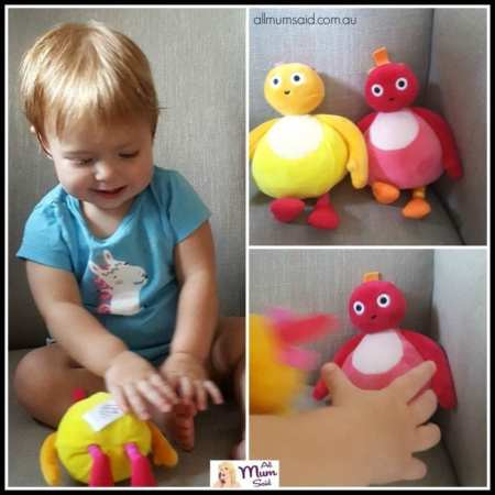 Toddler playing with Twirlywoos plush toys - Chickety and Toodloo