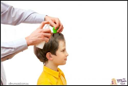 Head Lice Treatments Linked To Behaviour   dad checking for head lice