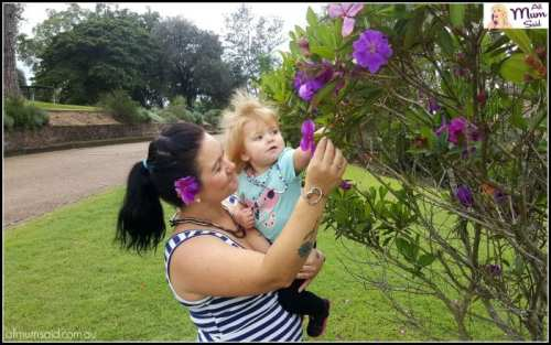 Mum and daughter picking flowers while wearing Knotlace Australian fashion Jewellery