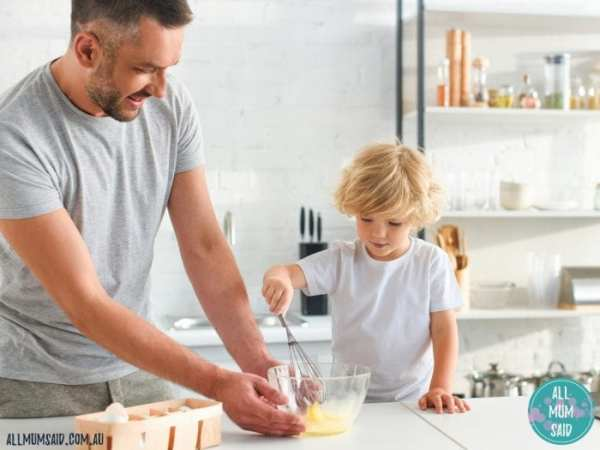 dad and son cooking dinner encouraging healthy eating habits