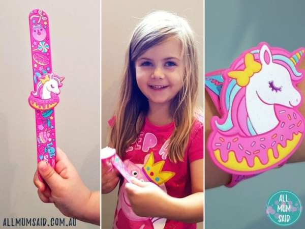girl wearing unicorn and doughnut Smiggle slapband
