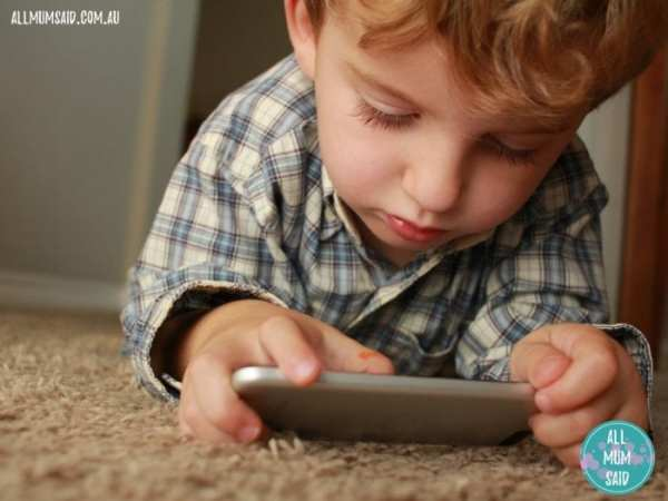 Tips to reduce screen time | young boy playing with phone