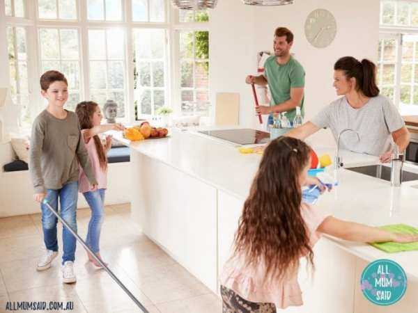 kids helping parents clean the kitchen