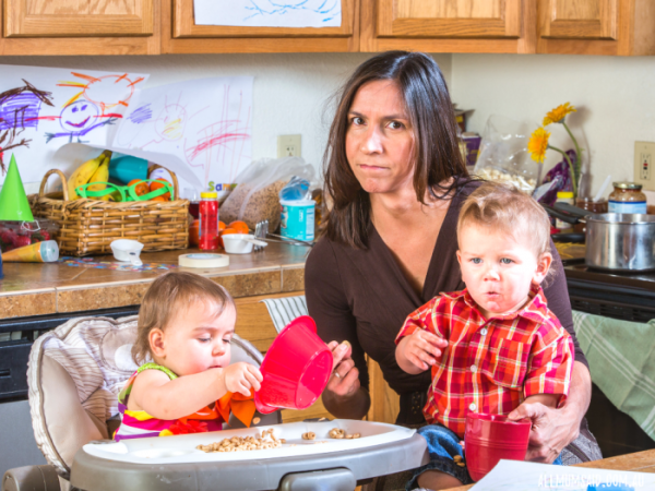 parenting styles - hot mess mum - stressed mum feeding toddler and baby