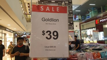 Price tag of some shirts at a sale