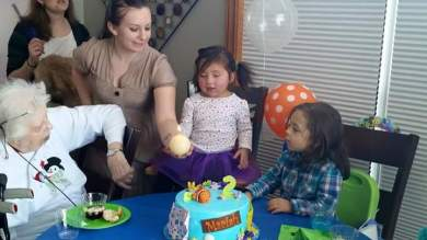 A taking the seat of honor by M to blow out her candles