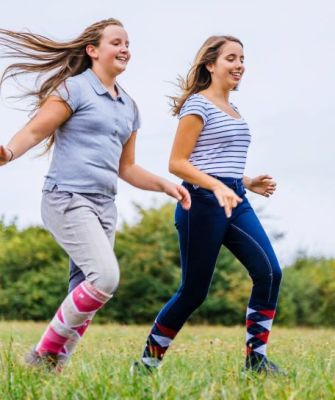 Two girls running-anfood