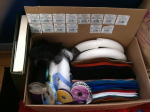 Old box turned into felt and ribbon storage. Save the tags so I know exactly what colors I have