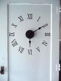 Repurposed Door Clock via http://www.remodelaholic.com/r-epurposed-door-to-large-wall-clock-diy/