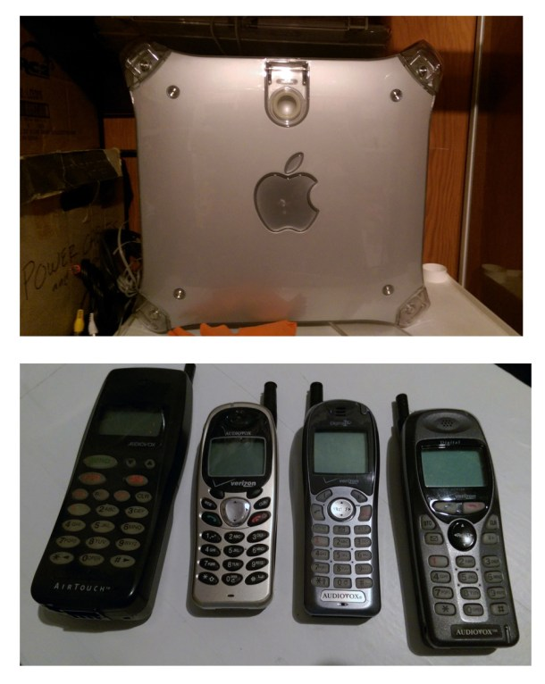 A Mac G4 Gray and some old cell phones. Man, those look clunky!