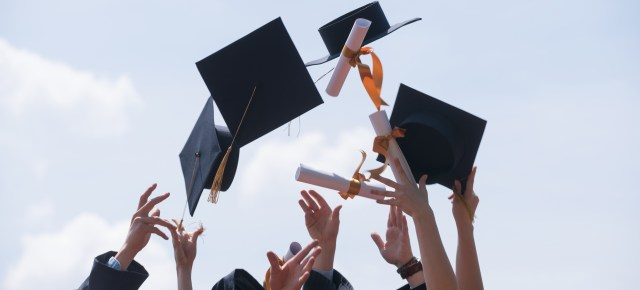 Graduation hats and diplomas thrown up in the air