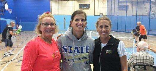 Alex, Julie Miller and Jennifer at Bainbridge High School Gym.