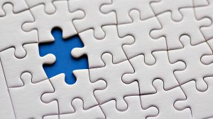 Abstract Art with White Jigsaw Puzzles