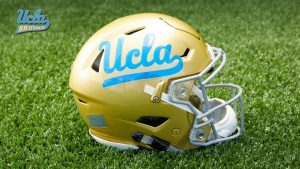 UCLA Football Wallpaper with Picture of Helmet on Grass