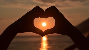 Romantic Wallpaper with Love Symbol in Sunset