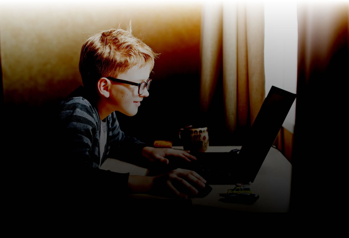 Website Privacy Policy - young boy on computer w filter