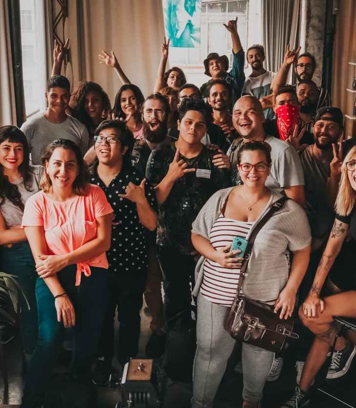 cheerful diverse friends gathering in modern studio