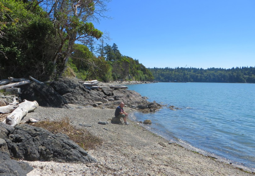 my dad sitting on a beach in anacortes