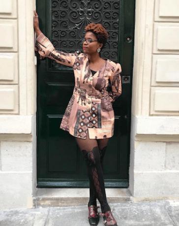 Woman standing in front of door in Paris