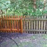 Wooden Fence Half Pressure Washed