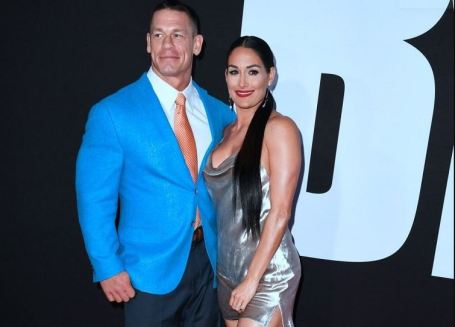 Elizabeth Huberdeau's husband, John Cena with his second wife, Nikki Bella.
