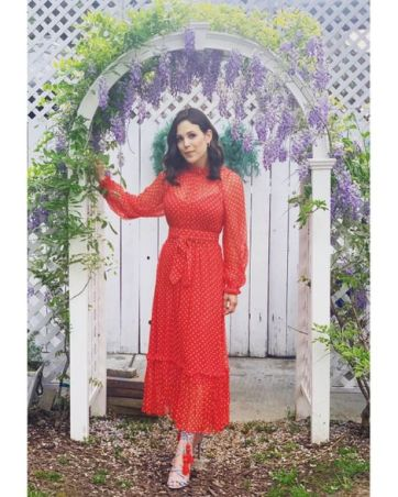 Erin Krakow in a red floral dress