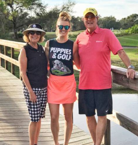 Amanda Balionis with her father and mother