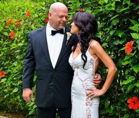 Deanna and Rick posing for their marriage pictures
