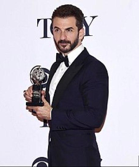 Michael Aronov winning a Tony Award for his performance in Oslo.